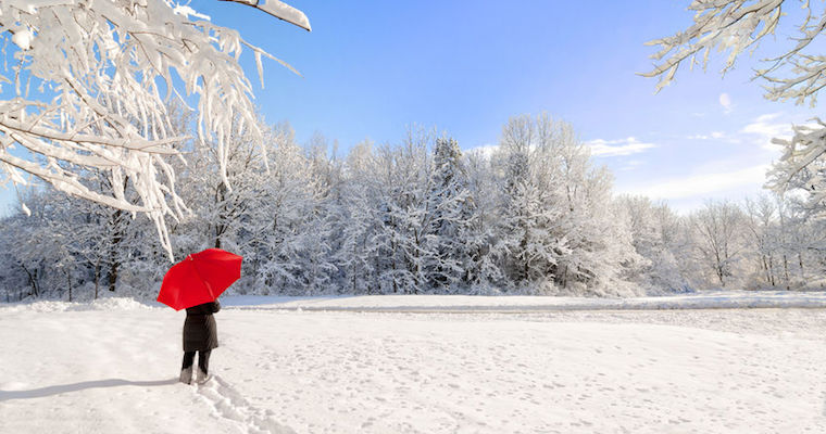 Person-with-red-umbrella-walking-in-snow